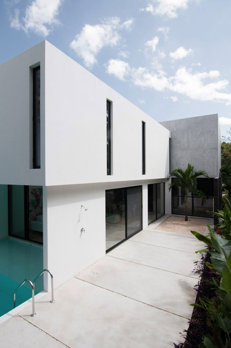 Minimalist house with two floors, simple facade design and chord colors 2