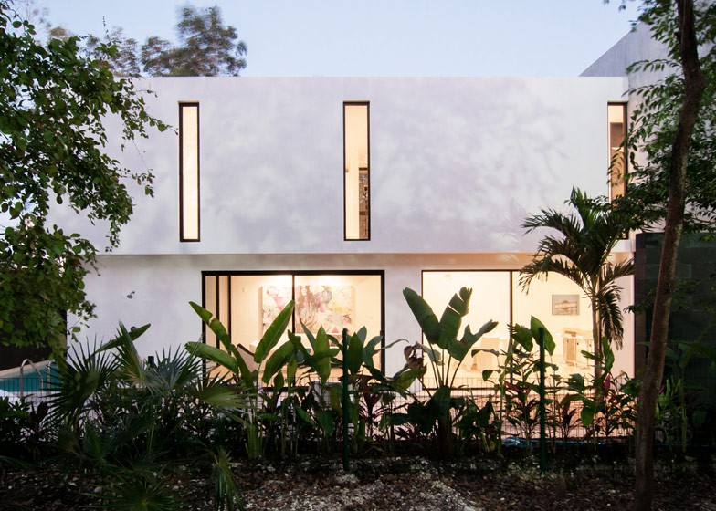 Minimalist house with two floors, simple facade design and chord colors 3