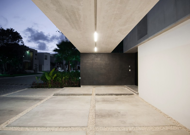 Minimalist house with two floors, simple facade design and chord colors 4