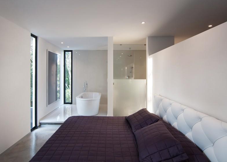 Casa Minimalista de dos pisos, diseño de Fachada simple y colores acorde 9