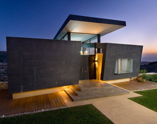 Utilización de Madera en el piso exterior y Bloques de Piedra Oscura en todas las paredes