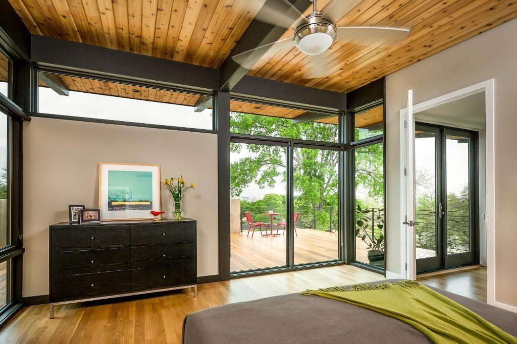 Planos de casa de dos pisos con fachada de madera y acero for Diseno de viviendas