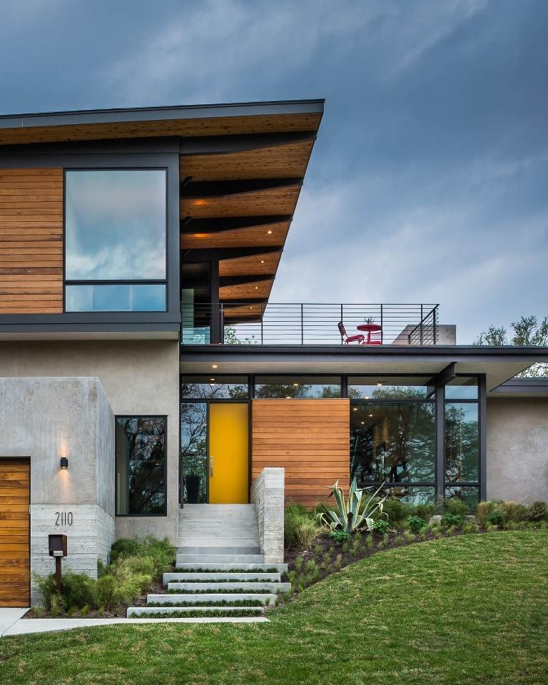 Planos de casa de dos pisos con fachada de madera y acero for Casas de madera de dos pisos