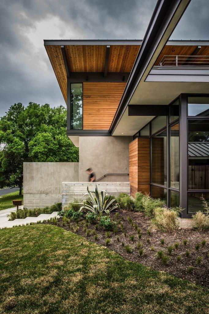 Planos de casa de dos pisos con fachada de madera y acero for Archi in casa moderna