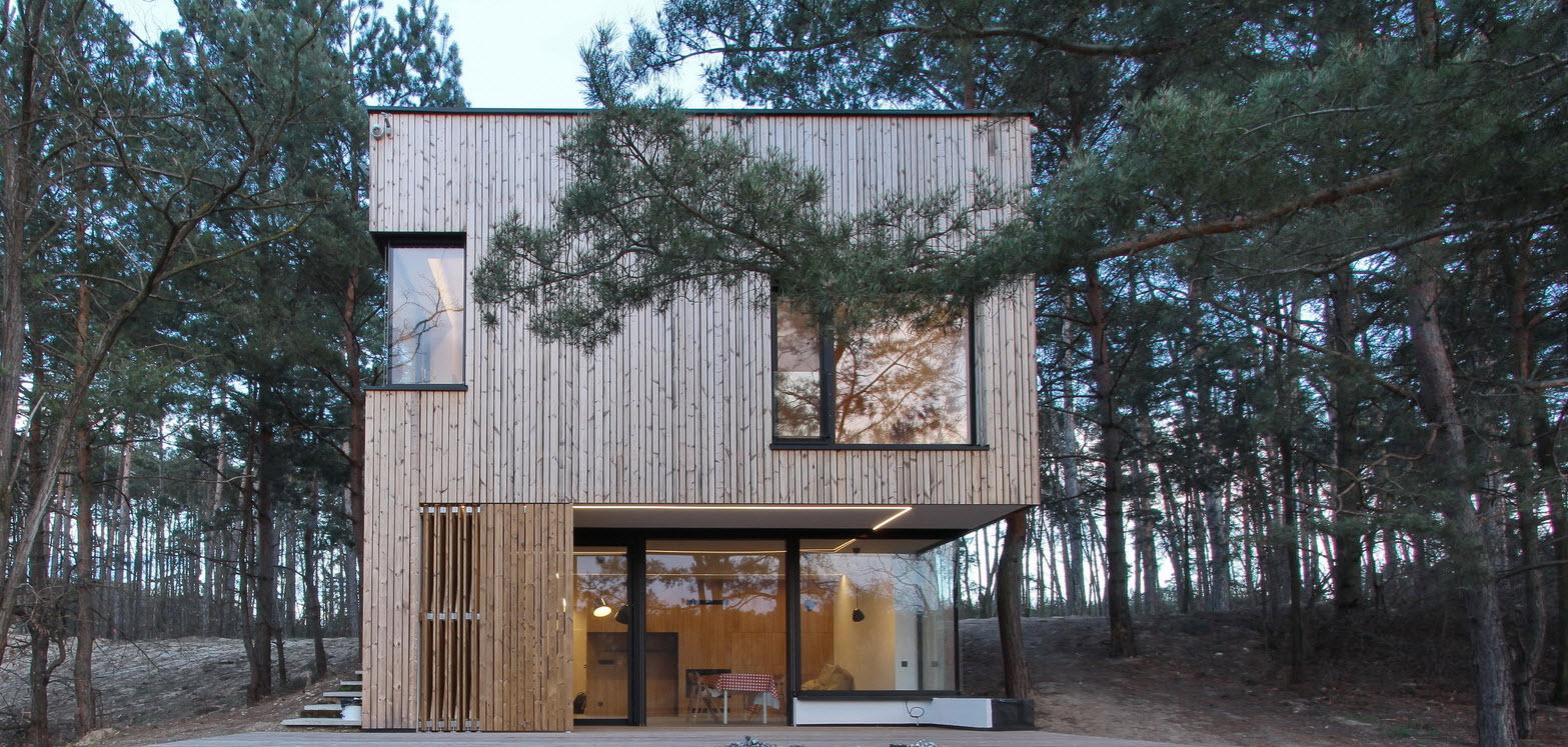 Casa de campo peque a con moderna estructura de madera for Casas de madera de dos pisos
