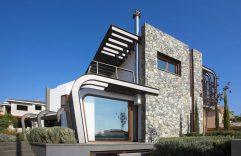 Diseño de casa moderna de dos plantas, disfruta de una divertida estructura ovalada de acero y dale rienda suelta a la imagación